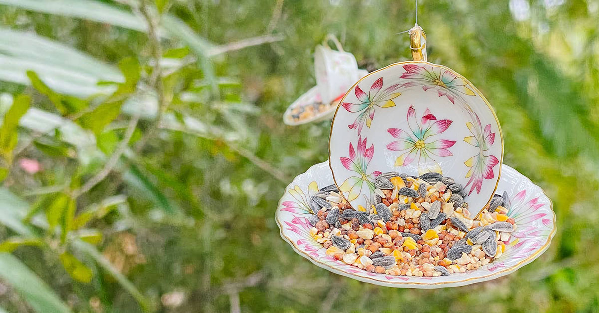 Bird feeder made with vintage teacup and Sugru