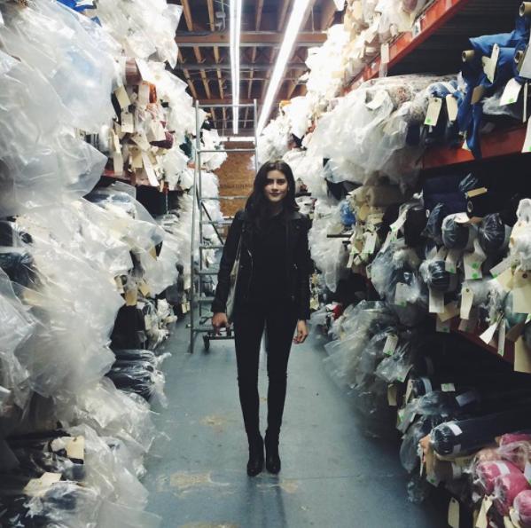 Lauren Singer in a fabric shop