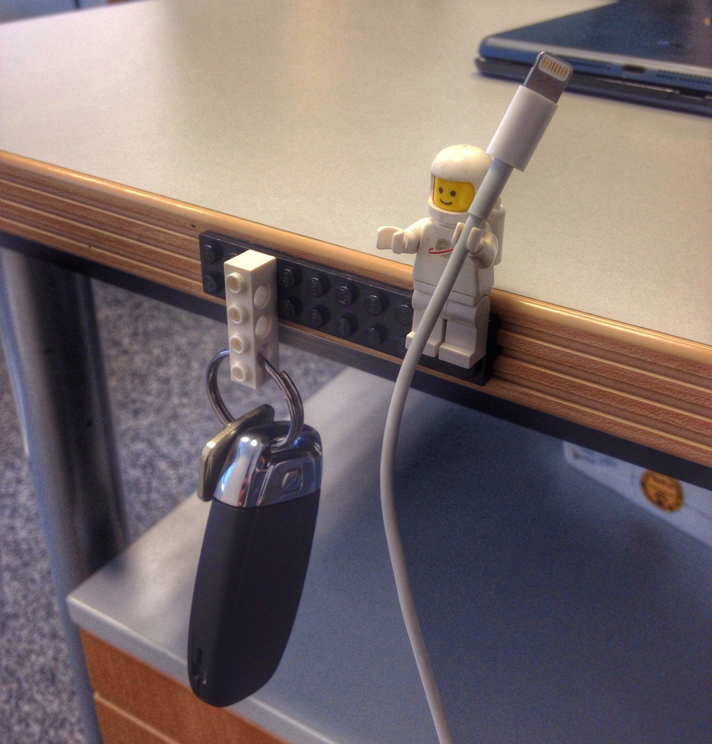 LEGO stuck down with Sugru holding keys and minifigure holding cable