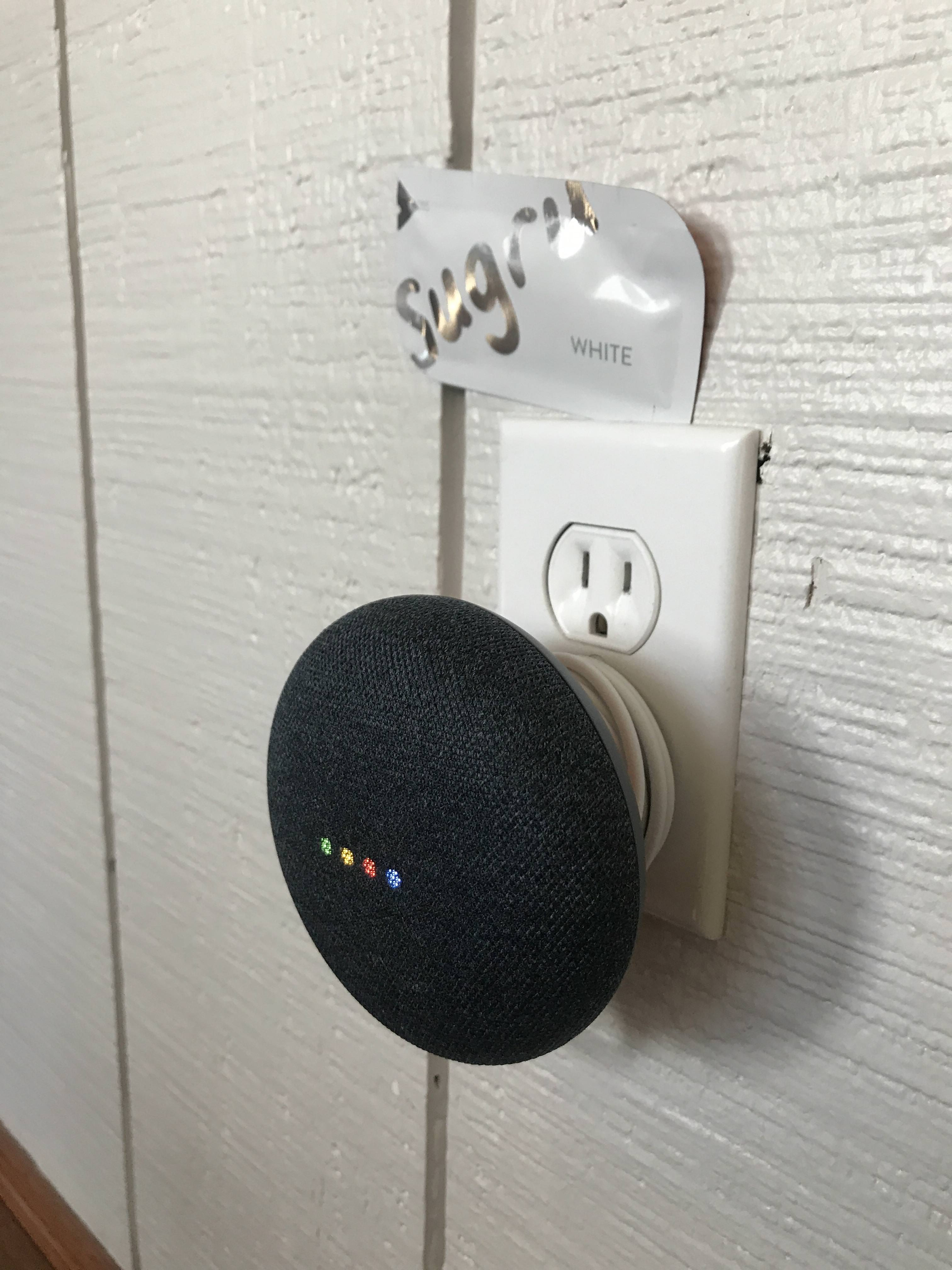 Google home device with cable wrapped at the back using Sugru