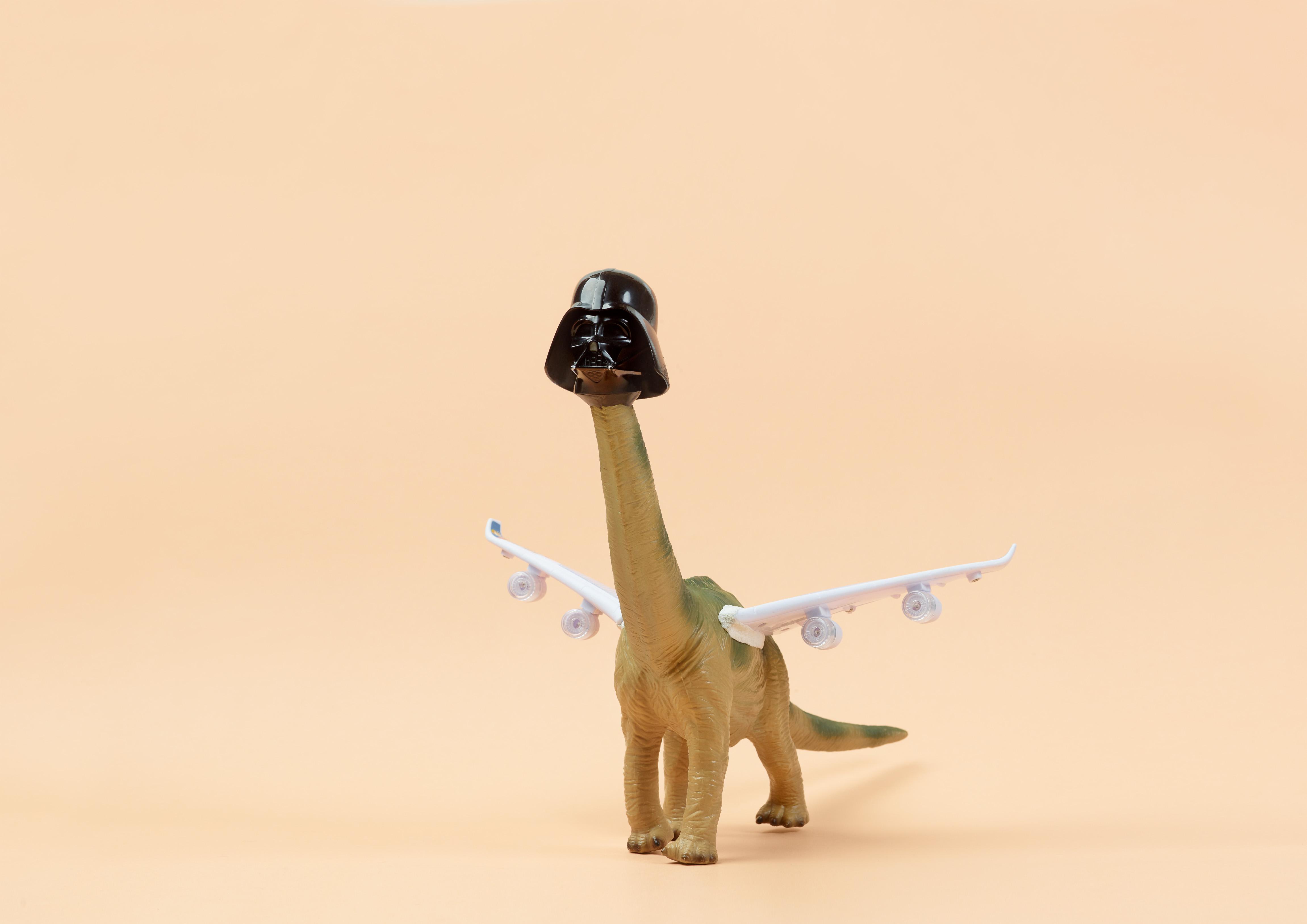 toy dinosaur with darth vader head