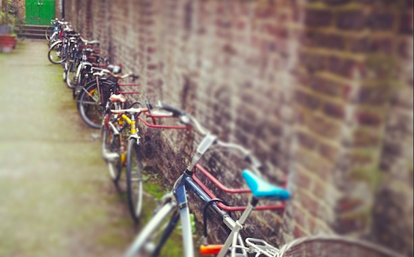 Locked bikes against a brick wall
