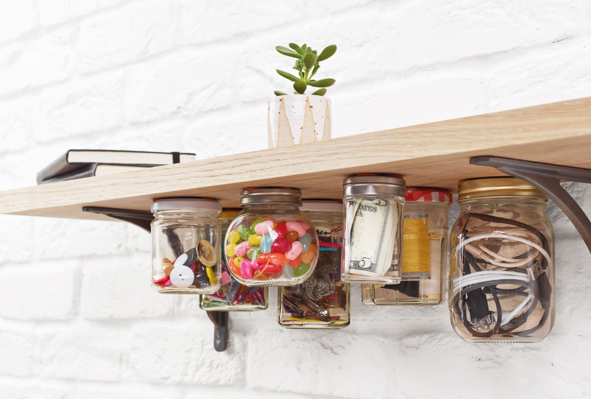 jars stuck to underside of shelf with sugru