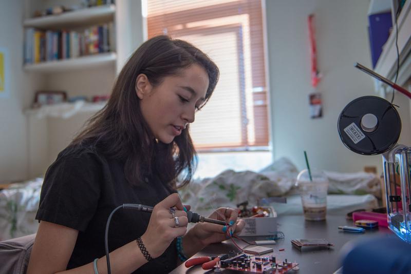 Ann Makosinski at her desk fixing tech