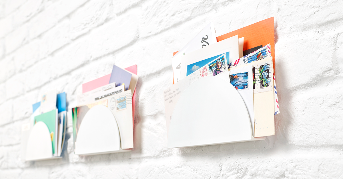 Letter holders mounted to a wall with Sugru