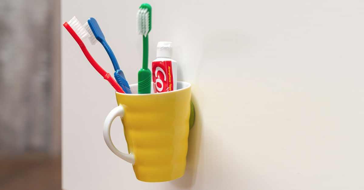 toothbrush holder stuck to wall with Sugru