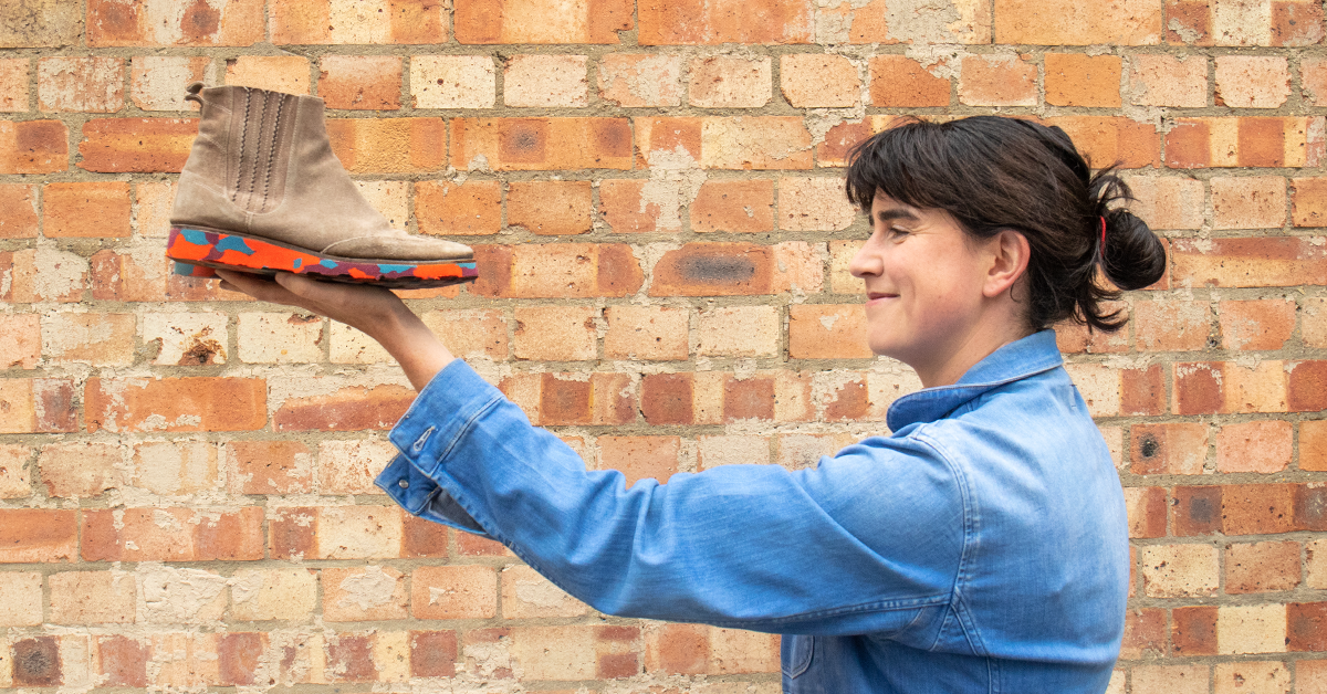Jane holding old shoe with new customised sole