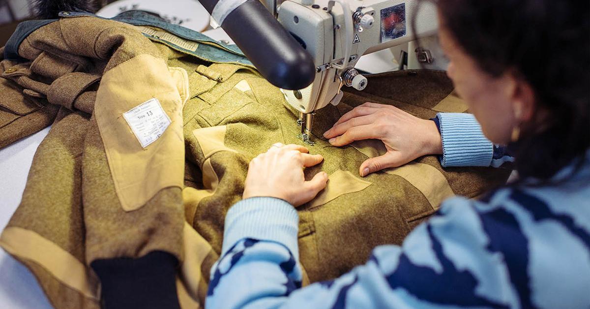 woman sewing a jacket