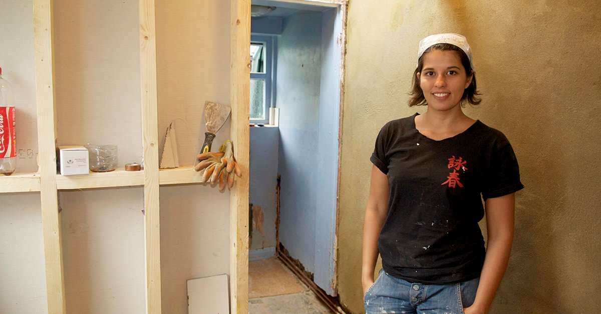 Jo Behari in a room being renovated