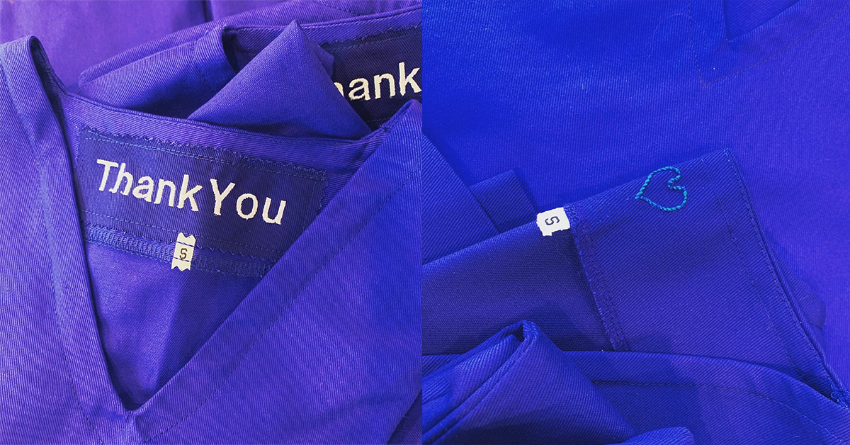 scrubs with hearts and thank you's sewn on