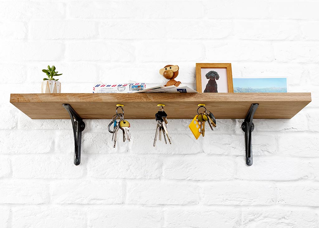 Sugru & magnets hold keys on the underside of a shelf