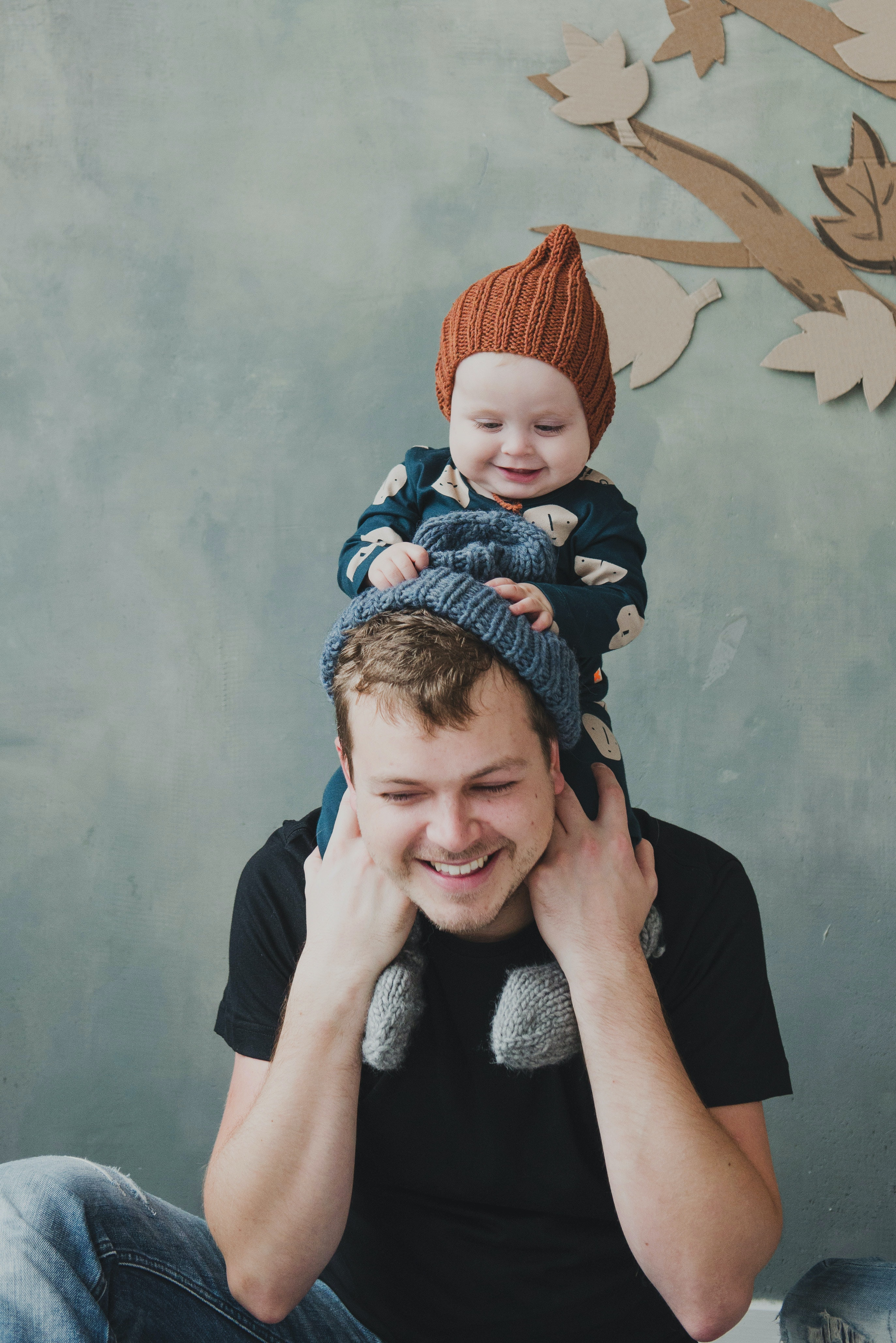 A man with his baby son on his shoulders