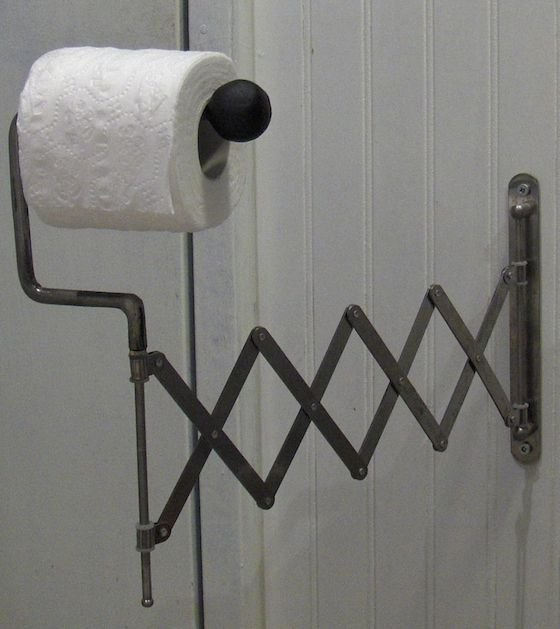 toilet roll holder with extending arm