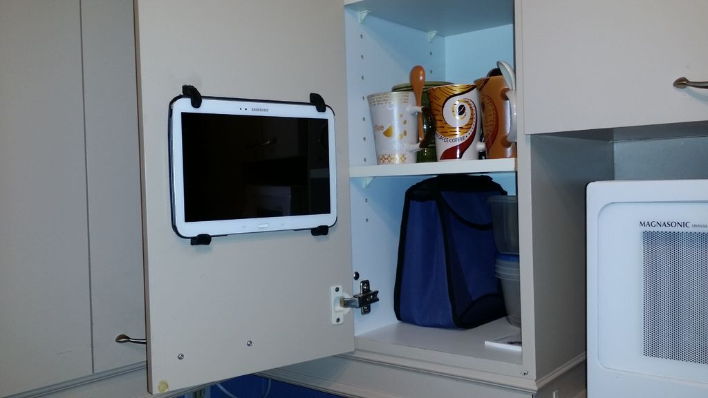 tablet mounted to inner cupboard door with sugru