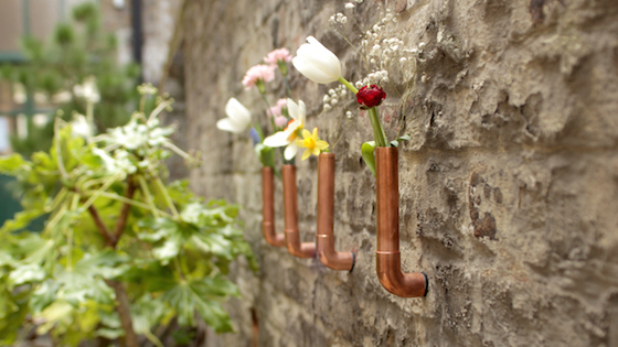 Copper vases stuck to brick wall with Sugru and magnets
