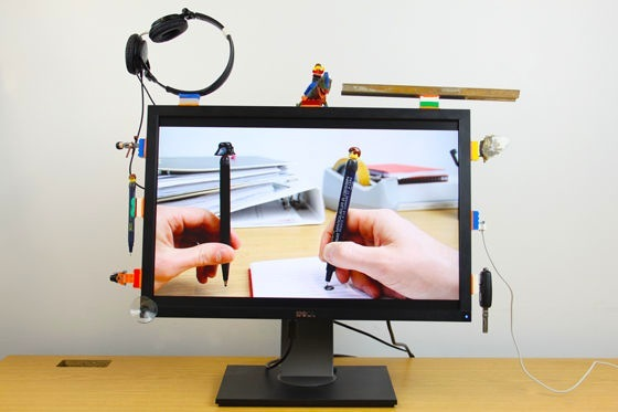 Objects attached to lego stuck down with Sugru on monitor