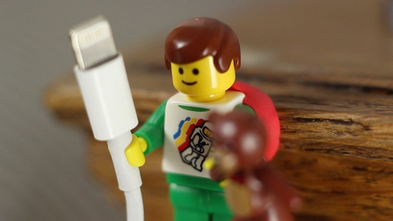 lego minifigure holding cable stuck down with sugru