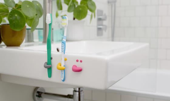 Sugru toothbrush holders on side of sink