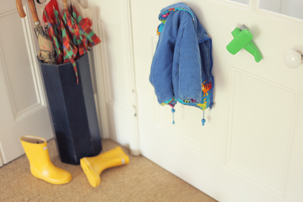 coat hangs from toy hook