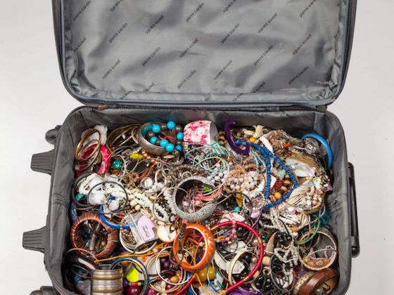 lots of old jewellery in a suitcase