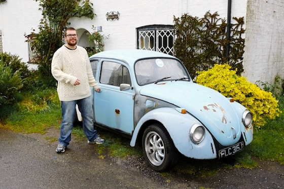 man next to old vw beetle car