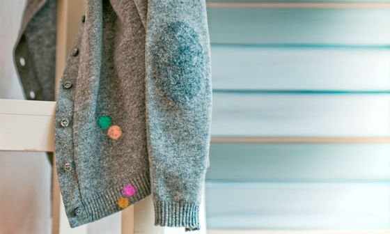 cardigan mended with woolfiller patches